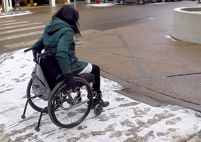 Street corner, snow and mobility challenges.
