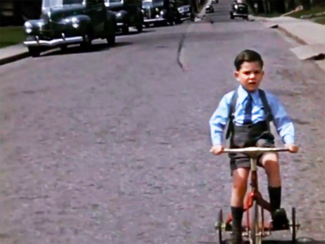 Young Leonard Cohen on a Tricycle